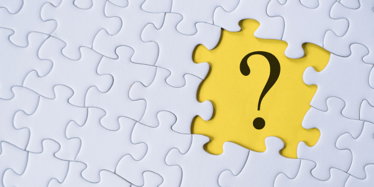 question mark on jigsaw puzzle with yellow background. question