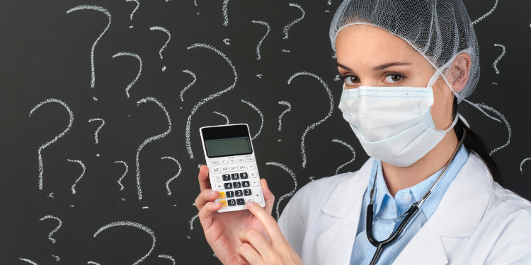 female doctor with calculator in front of question marks