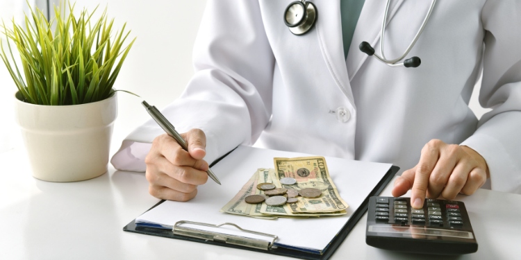 doctor counting money hospital budget problems
