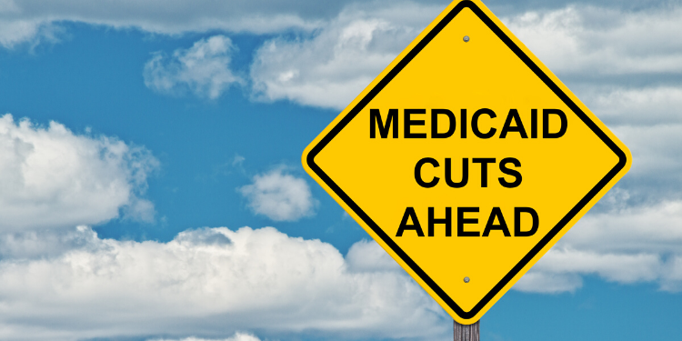 warning sign that says medicaid cuts ahead