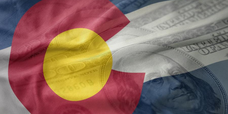 flag of Colorado with US currency overlay